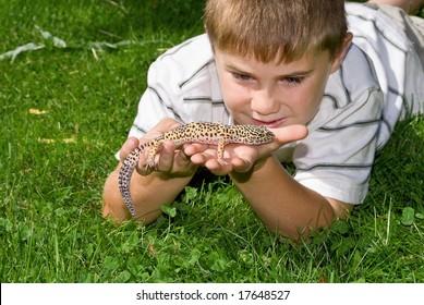Boy holding his pet Gecko Lizard
