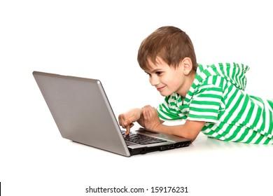 Boy holding a laptop isolated on white background