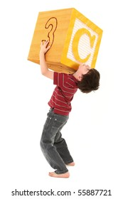 Boy holding a large letter C alphabet block over white.
