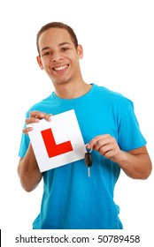 Boy holding learner plate and car key isolated on white