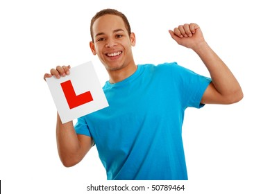 Boy holding learner plate isolated on white