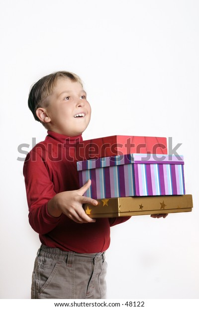 Boy holding lots of gifts