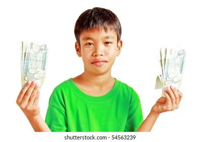 A boy holding Philippines peso bills
