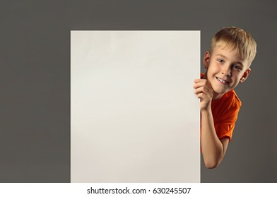 boy holding a poster