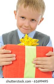 boy holding present box . Isolated on white background