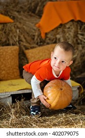 Boy holding a pumpkin. Autumn decor. Halloween