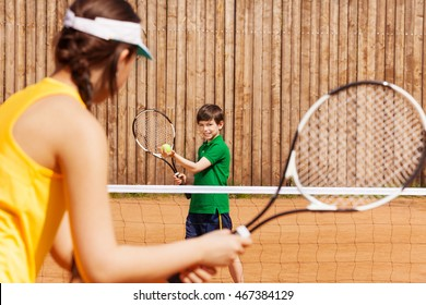 Boy holding tennis ball and racket, starting set