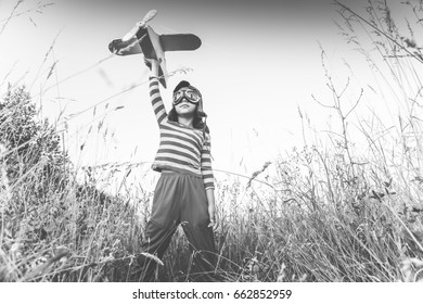 boy holds a plane and plays