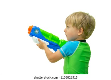 Boy holds water gun isolated on white