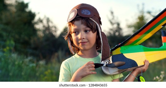 boy with homemade radio-controlled model aircraft (airplane is hand made not copyright)