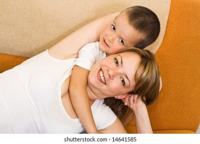 Boy hugging his mother