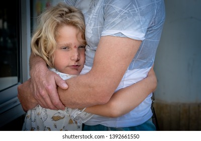 The boy hugs his father tightly. Israel, Ashdod May 2019