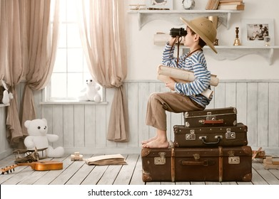 Boy in an image of the traveler with maps and binoculars