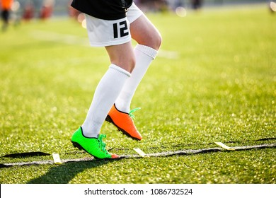 Boy Improving Speed With Ladder Drills on Football Field. Young Soccer Player Training Agility on the Pitch. Soccer Individual Skills Training