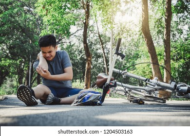Boy injury hurts from falling bike, hurt on his arms, pain ache from workout concept
