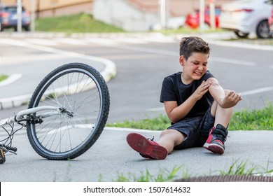 Boy injury hurts from falling bike, hurt on his arms, pain ache from falling off the bicycle