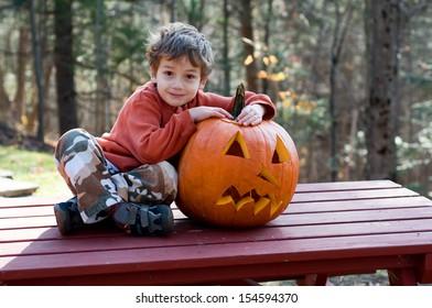Boy with a jack o lantern