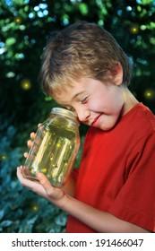 Boy with a jar of fireflies