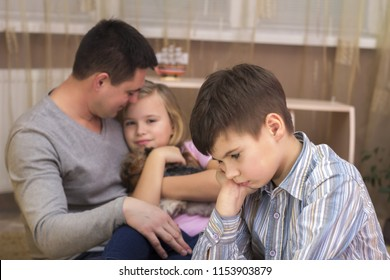 The boy is jealous of his father's sister and sad