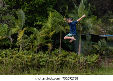 Boy jumping high into the air