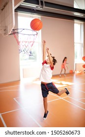 Boy jumping high. Boy jumping high while training and playing basketball at PE lesson