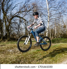 boy jumping with his dirt bike in outdoor area
