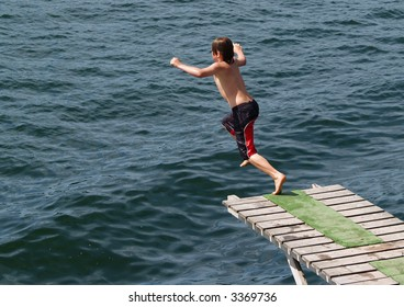 Boy jumping into the sea.