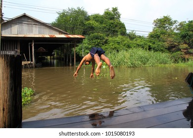 A boy is jumping into the water