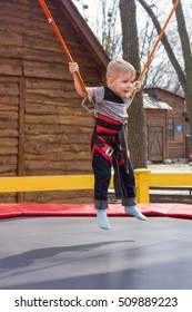 Boy is jumping on the trampoline