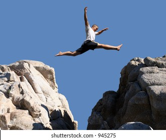 Boy jumping over the mountains