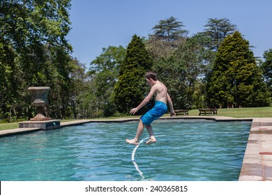 Boy Jumping Pool Boy jumping into swimming pool  home summer.