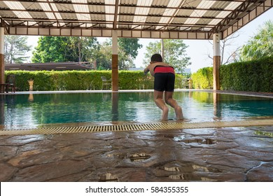 Boy jumping to swimming pool