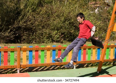 Boy jumping from swing