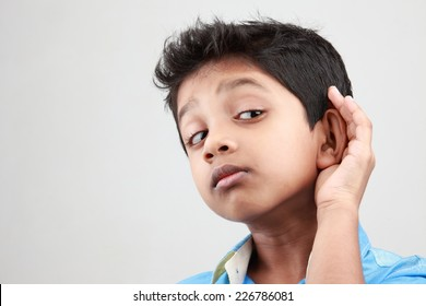 Boy keen on listening to a low voice