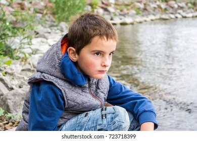 Boy, kid on a journey at the lake