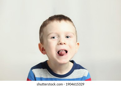 Boy, kid performs articulation exercises for the tongue, correct pronunciation, vocals, dental concept, speech therapy.