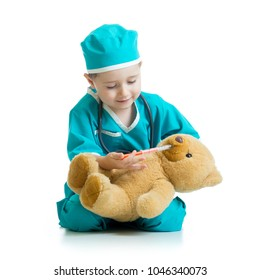 boy kid playing doctor with teddy bear