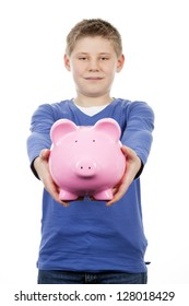 boy kissing pink piggy bank on white background