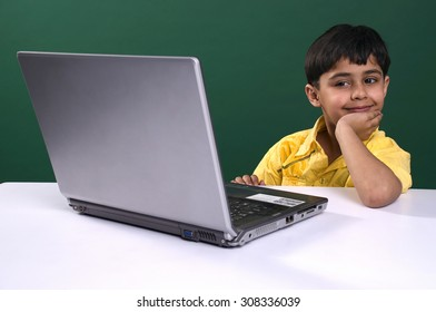 A boy with a laptop