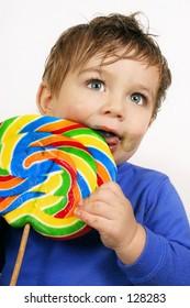 Boy with a large lollipop