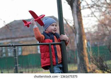 The boy launches a toy plane