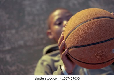 Boy laying down and holding basketball