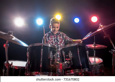 Boy, learn to play drums