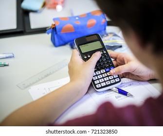 Boy learning mathematical class school