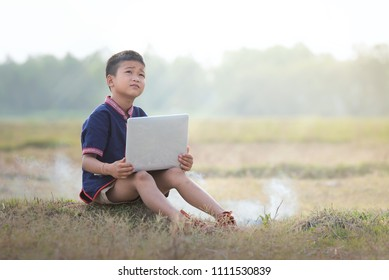 Boy learning with online learning with laptops outdoors.