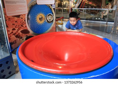 A boy learns about the gravity concept at the science learning center, Bankok - Thailand, 18 April 2019