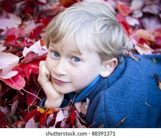Boy In The Leaves