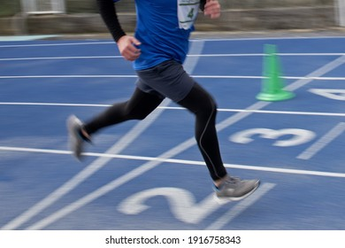 boy legs running on arrival on an athletics field