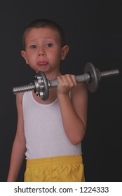 Boy lifting weights