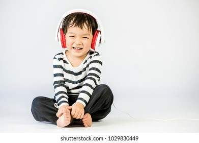 Boy listen to music on a white background